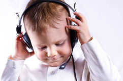 Young boy wearing telephone headset Royalty Free Stock Images