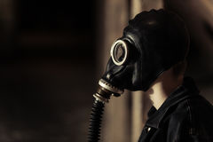 Young boy wearing a vintage gas mask Stock Photos