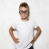 Young boy wearing white tshirt and black Royalty Free Stock Photos