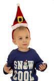 Young boy wearing winter pajamas and santa hat Royalty Free Stock Photography