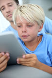 Young boy websurfing on tablet Royalty Free Stock Image