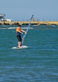 Young boy windsurfing and having fun Royalty Free Stock Photography