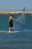 Young boy windsurfing and having fun Royalty Free Stock Images