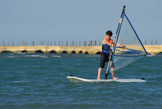 Young boy windsurfing and having fun Royalty Free Stock Photos
