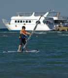 Young boy windsurfing and having fun Royalty Free Stock Image