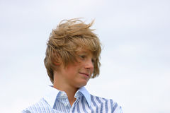 Young boy with windswept hair Stock Photo