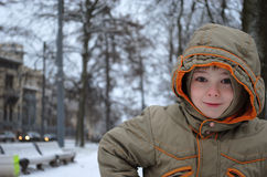 Young boy in winter city park Stock Photos