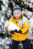 Young boy in winter park Stock Image