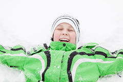 Young boy in winter snow laughing with enjoyment Stock Photography