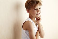 Young boy on wooden background Royalty Free Stock Photo