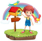 A young boy and the wooden pethouse and signboard Stock Photo