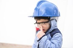 Young boy with work helmet. Ready for continue working in little constructions Stock Photos