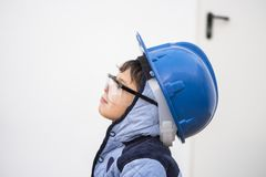 Young boy with work helmet. Ready for continue working in little constructions Stock Image