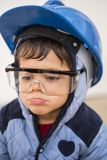 Young boy with work helmet. Ready for continue working in little constructions Royalty Free Stock Image