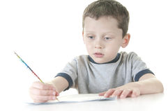 Young boy working at school Stock Images