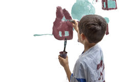 Young boy works on painting. Royalty Free Stock Photos