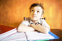 A young boy worried  and stressed on homework. A young boy worried on homework Royalty Free Stock Photography