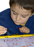 Young boy write Stock Image