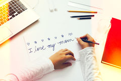 Young boy writes letter to mother Royalty Free Stock Photography