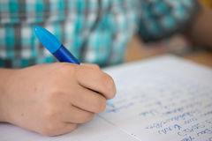 Young boy writing Royalty Free Stock Photography