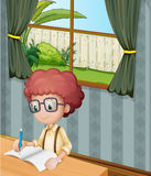 A young boy writing inside the house stock illustration