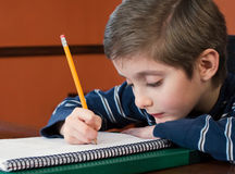 Young boy writing in notebook Royalty Free Stock Photography