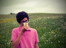 Young boy wuith allergy with vintage effect Stock Photography