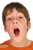 Young boy yawning. Photo of a young boy yawning Royalty Free Stock Image