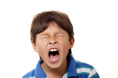 Young boy yawning Royalty Free Stock Images