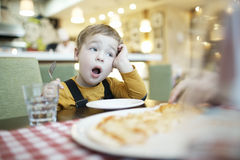 Young boy yawning as he waits to be fed Royalty Free Stock Images