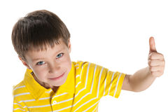 Young boy in a yellow shirt holds his thumb up Stock Photography