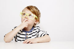 Young boy in yellow specs Royalty Free Stock Photo