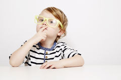 Young boy in yellow specs Stock Photos
