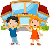 Young boy and young girl in front of the school Stock Photography