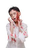 Young boy in zombie make up and costume Stock Photography