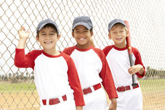 Young Boys In Baseball Team. Lined Up Smiling To Camera Royalty Free Stock Photos