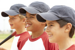 Young Boys In Baseball Team. Smiling Off Camera stock images