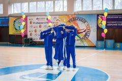 Young boys cheerleaders perform at the city cheerleading championship. Kamenskoye, Ukraine - March 9, 2017: Championship of the city of Kamenskoye in Royalty Free Stock Photo