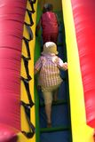 Young boys climbing inflatable bouncy. At park playground Royalty Free Stock Photos