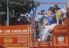Young boys and dog in historic fire truck Royalty Free Stock Images