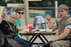 Young Boys Eating at the Medieval Faire in Brooks Stock Photos