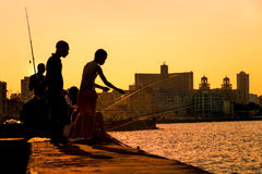 Young boys fishing at sunset in Havana Royalty Free Stock Photo