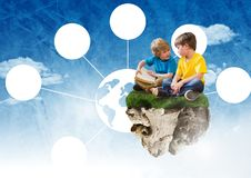 Young boys on floating rock platform  in sky reading books with world connectors interface Royalty Free Stock Image