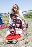Young boys and girls in campsite. Piled up smiling royalty free stock image