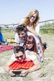 Young boys and girls in campsite. Piled up smiling stock photo