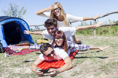 Young boys and girls in campsite. Piled up smiling royalty free stock photo
