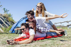 Young boys and girls in campsite. Piled up smiling royalty free stock photos