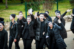 Young boys and girls masked as mimes participate in the masquerade Royalty Free Stock Photography