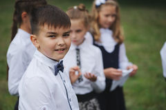 Young boys and girls in uniform outdoors. Group of young boys and girls in uniform outdoors royalty free stock image