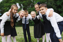 Young boys and girls in uniform outdoors Royalty Free Stock Photo